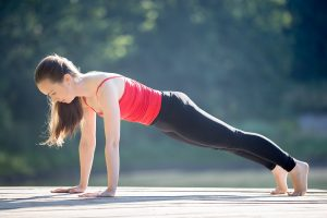 Teenage girl in plank pose
