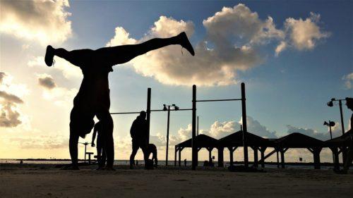 stradle-handstand-dark-sky-beach